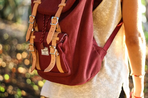 Girl with maroon Hershel backpack