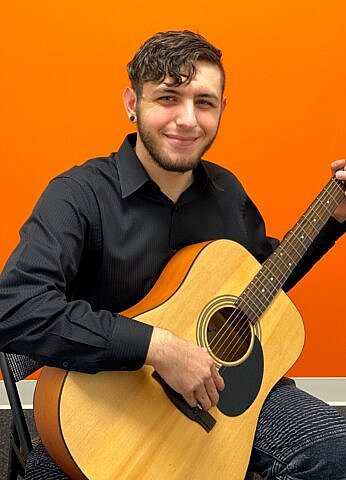 Anthony Villani, Guitar and Bass teacher at Center Stage Music Center.
